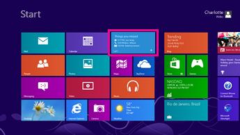 Skjermbilde av startskjermen i Windows med statusoppdateringer på den uthevede Lync-flisen.