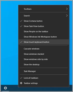 """Onde encontrar a opção """"Mostrar botão de teclado tátil"""" na barra de tarefas."""