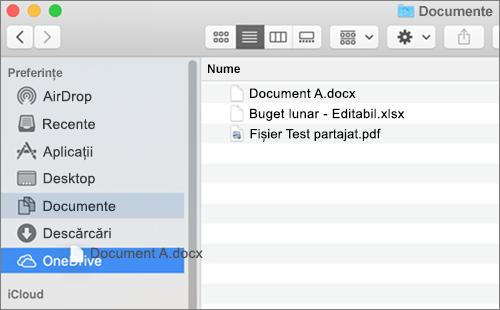 Fereastra Finder Mac afișând glisare și fixare pentru a muta fișiere