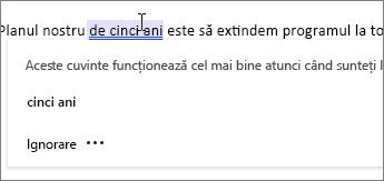 Faceți clic direct pe un termen semnalizat pentru a obține sugestii pentru Editor.