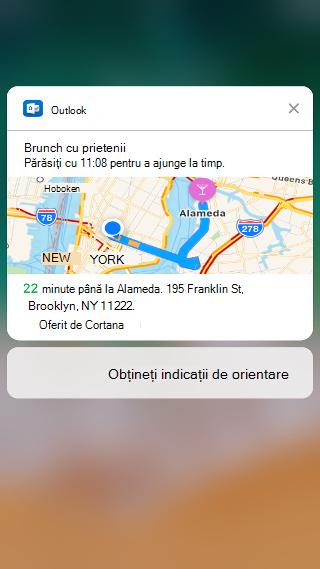 """Ecranul afișează o notificare Outlook care spune """"brunch cu prietenii. Lăsați până la 11:08 pentru a ajunge la timp """"și include o hartă, cu estimarea timpului de călătorie listat sub aceasta."""