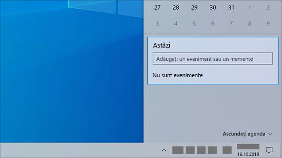 Un câmp de introducere a calendarului din bara de activități a PC-ului