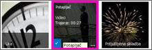 Posnetek zaslona videoknjižnice. Dva od videov v knjižnici imata sličici vsebine videa, ena slika pa prikazuje le grafiko filma.