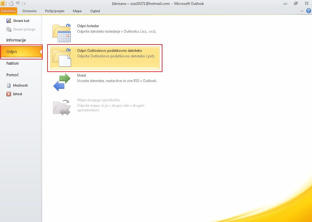 Click the File tab, Open, and Open Outlook Data File.