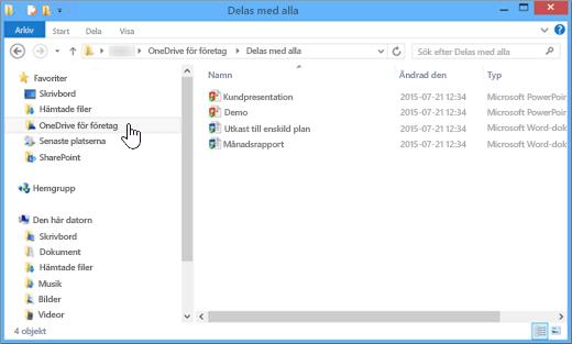 En skärmbild som visar hur den ser ut i Utforskaren efter att du synkroniserat en OneDrive för företag-fil och skrivbordet