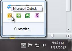 Aviseringsområdet har gjorts större för att visa Outlook-ikonen