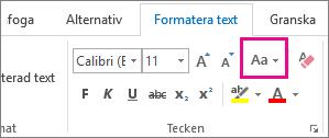 Knappen Ändra skitfläge på fliken Formatera Text