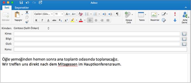 İngilizce cümle ve yanlış yazılmış bir Almanca sözcük içeren Almanca cümle. Yazım hatasının altı kırmızıyla çizili.
