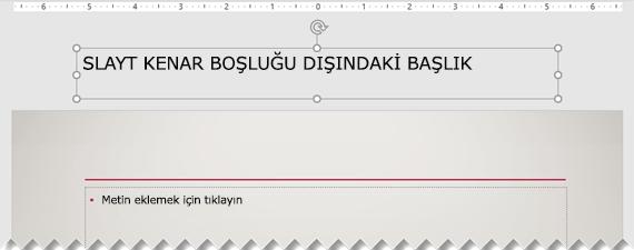 Görünür slayt kenar boşluğu dışında yerleştirilen bir slayt başlığı.