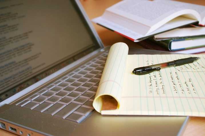 photo of a writing pag and pen