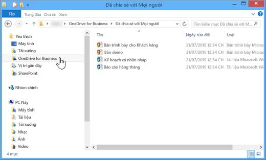 Ảnh chụp màn hình của giao diện File Explorer sau khi bạn đồng bộ tệp OneDrive for Business và màn hình máy tính