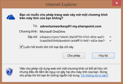 Ảnh chụp màn hình hộp thoại trong Internet Explorer yêu cầu quyền để mở Microsoft OneDrive