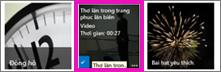 Ảnh chụp màn hình một thư viện video. Hai trong số các video trong thư viện có hình thu nhỏ về nội dung video, và một hình chỉ hiển thị đồ họa thể hiện một đoạn phim.